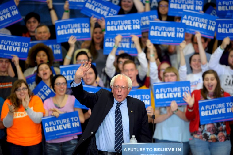 Image: U.S. Democratic presidential candidate Sanders waves to the crowd as he takes the stage at a campaign rally at Cornell College in Mount Vernon, Iowa