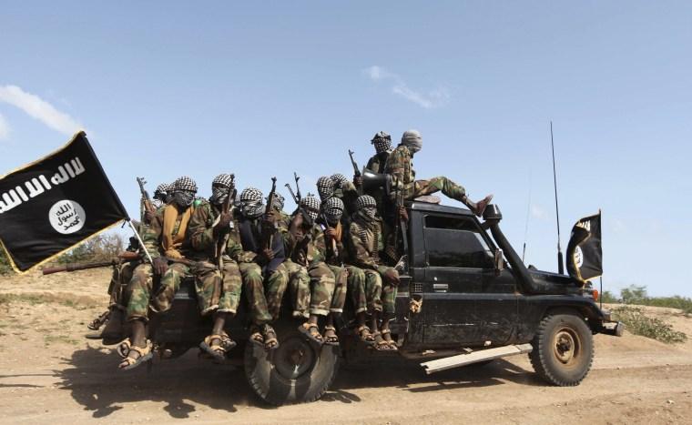 Image: Members of al Shabaab ride in a pick-up truck outside Somalia's capital Mogadishu