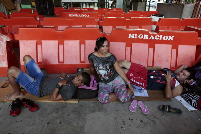 Image: Cuban migrants rests at a temporary shelter in the border between Costa Rica and Nicaragua in Penas Blancas, Costa Rica