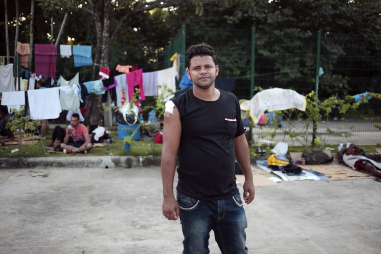 Image: Cuban migrant Lenin Rivacoba stands at the border between Costa Rica and Nicaragua, Penas Blancas