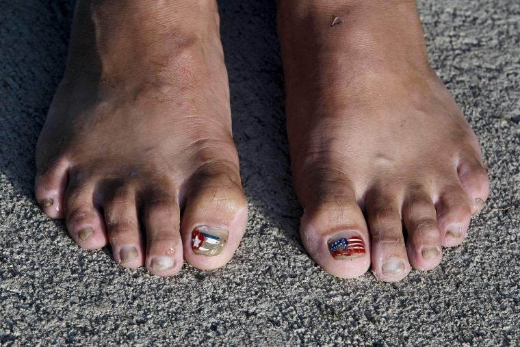 Image: Cuban migrant shows her toes decorated with the flags of Cuba and the United States at a temporary shelter in a school in the town of La Cruz, Costa Rica