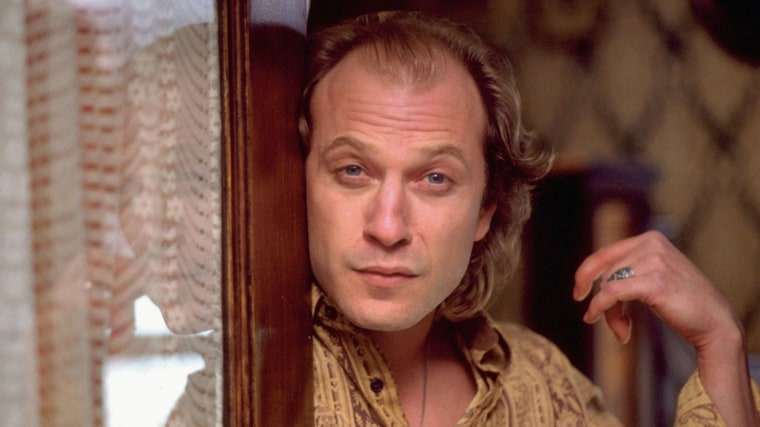 Buffalo Bill, Played By Ted Levine, Stands At The Front Door Of The Home