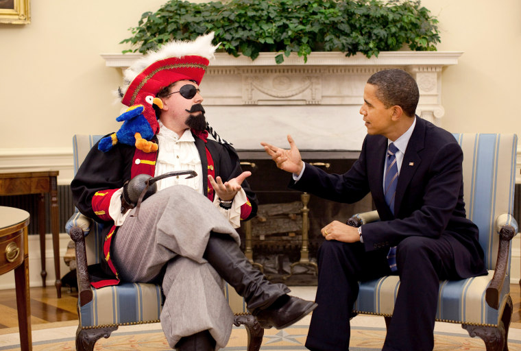 President Barack Obama with speechwriter Cody Keenan, who dressed as a pirate for an Oval Office photo shot for use in the President's speech to the White House Correspondents Association dinner May 9, 2009.