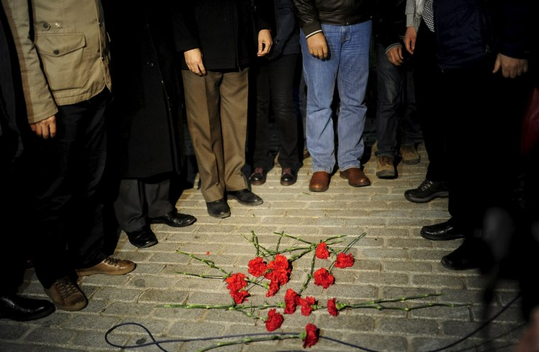 Image: Members of the Istanbul Medical Chamber place carnations near the blast site at Sultanahmet square in Istanbul