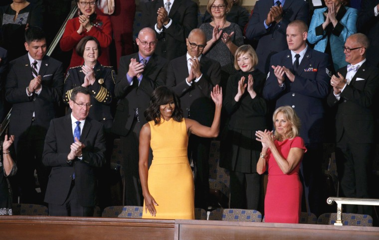 Image: U.S. first lady Michelle Obama waves from her box in the gallery while attending U.S. President Barack Obama's State of the Union address to a joint session of Congress in Washington