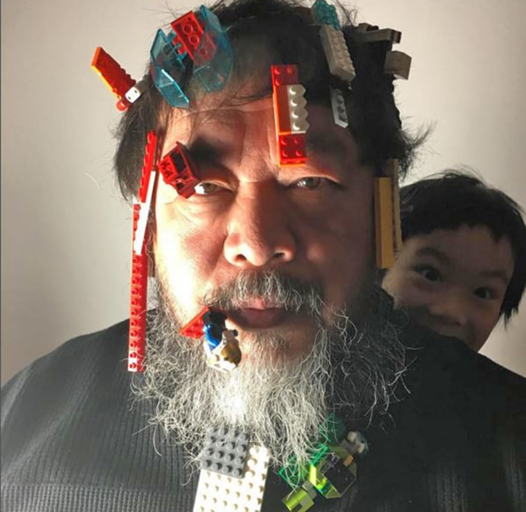 Artist Ai Weiwei poses with Lego bricks on his face in a picture posted to his Instagram account.
