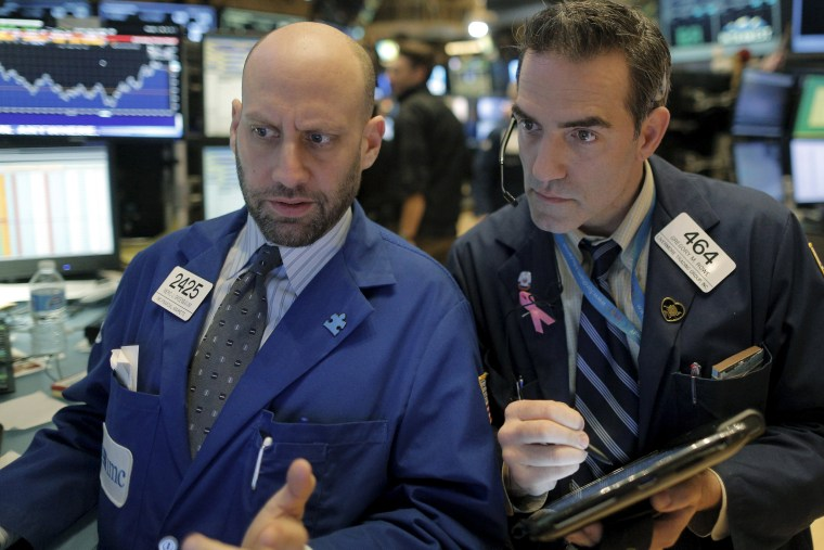 Image: Specialist trader Meric Greenbaum gives a price quote to trader Greg Rowe on the floor of the New York Stock Exchange