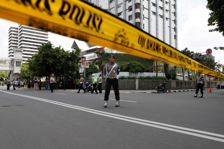 Image: Police cordon sealing off the scene of the bomb blast