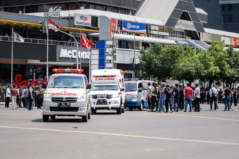 Image: Policemen and ambulance arrive in front of Sarinah shopping mall