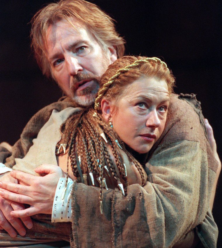 """British actors Helen Mirren and Alan Rickman perform during a photocall rehearsal for \""""Anthony and Cleopatra\"""" at the Olivier Theatre in London in 1998."""