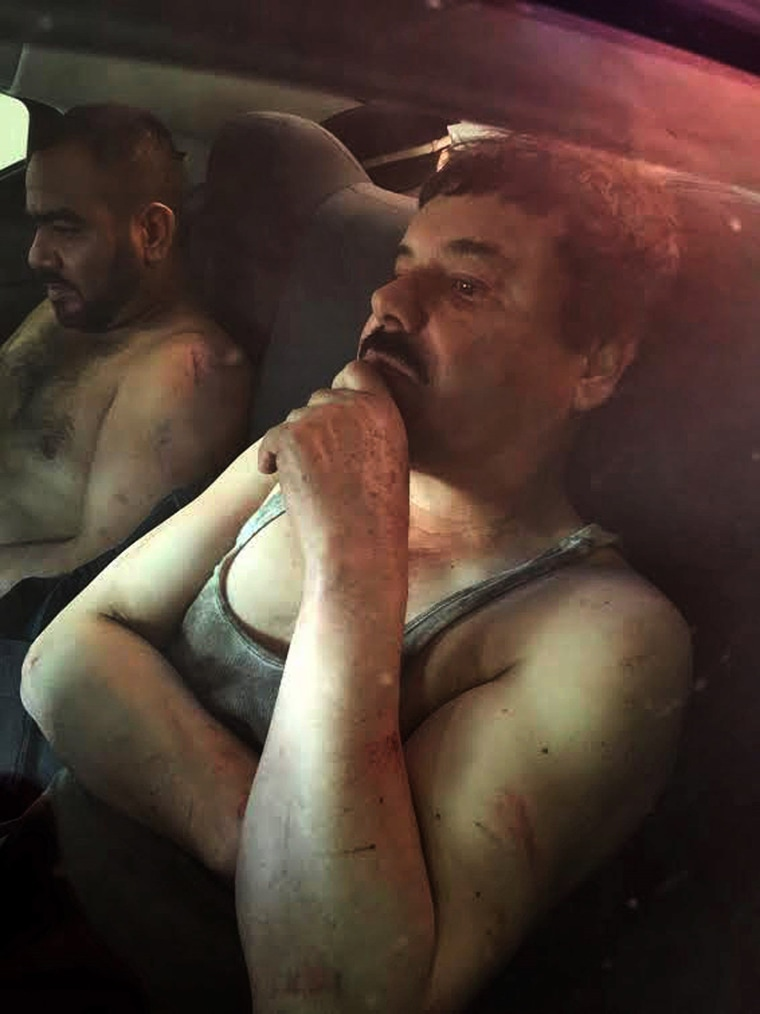 "Image: Joaquin ""El Chapo"" Guzman sits in a vehicle after he was recaptured in the city of Los Mochis"