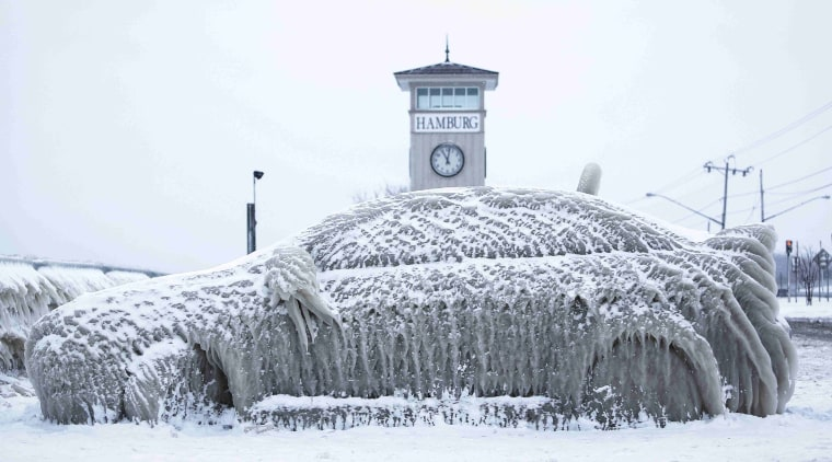 Image: A car covered with ice remains stranded on the waterfront in Hamburg, New York