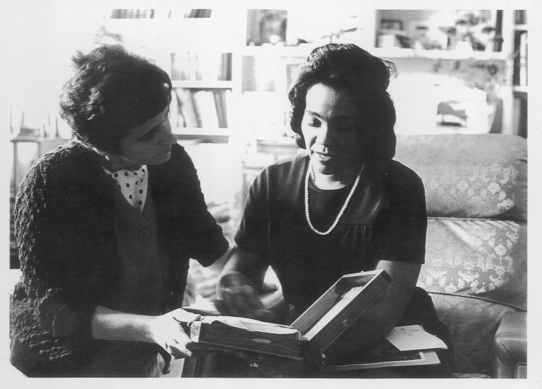 Coretta Scott King and AP reporter Kathryn Johnson on the campus of Atlanta University, Ga., reviewing plans for The King Center, 1968. (AP Photo) )