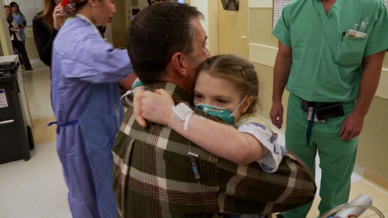 Lindsey hugging her father Jason before her heart transplant surgery in 2013.