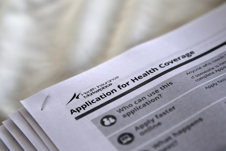 The federal government forms for applying for health coverage are seen at a rally held by supporters of the Affordable Care Act outside the Jackson-Hinds Comprehensive Health Center in Jackson, Mississippi, in this October 4, 2013, file photo.