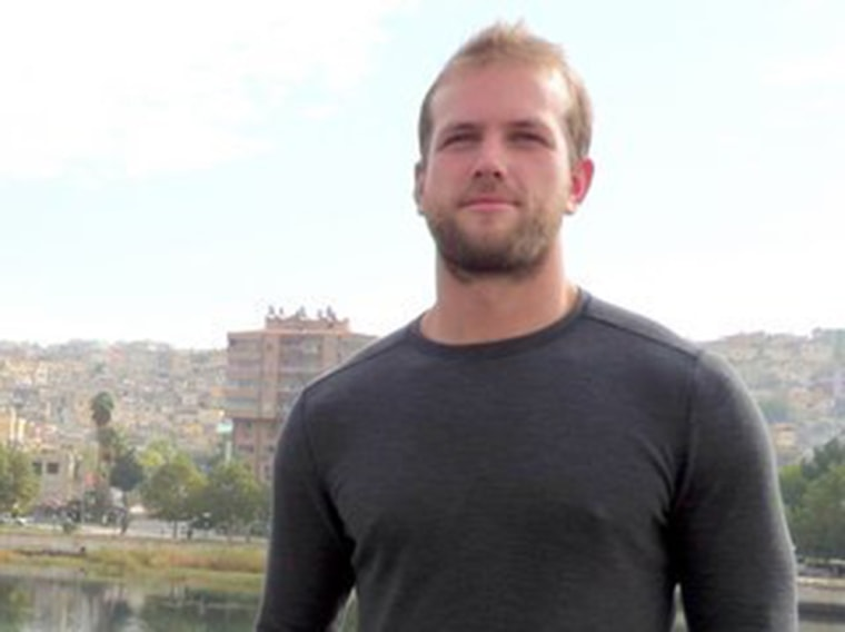 Matthew Trevithick stands near the Syrian border.