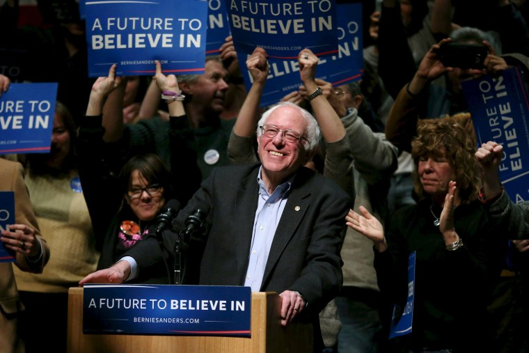 Image: U.S. Democratic presidential candidate and Senator Bernie Sanders smiles as he takes the podium to speak during a campaign rally in Amherst