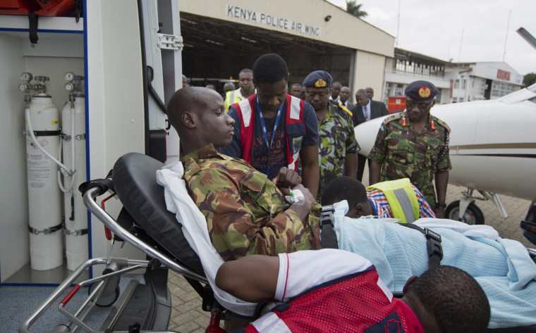 Image: A Kenyan soldier injured in the attack by al-Shabab in Somalia is carried on a stretcher