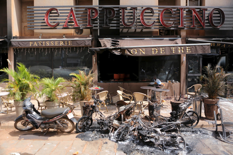 """Image: The burned-out exterior of """"Cappuccino"""" restaurant is seen in Ouagadougou"""
