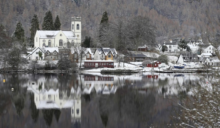 Image: Kenmore is reflected in Loch Tay  Scotland
