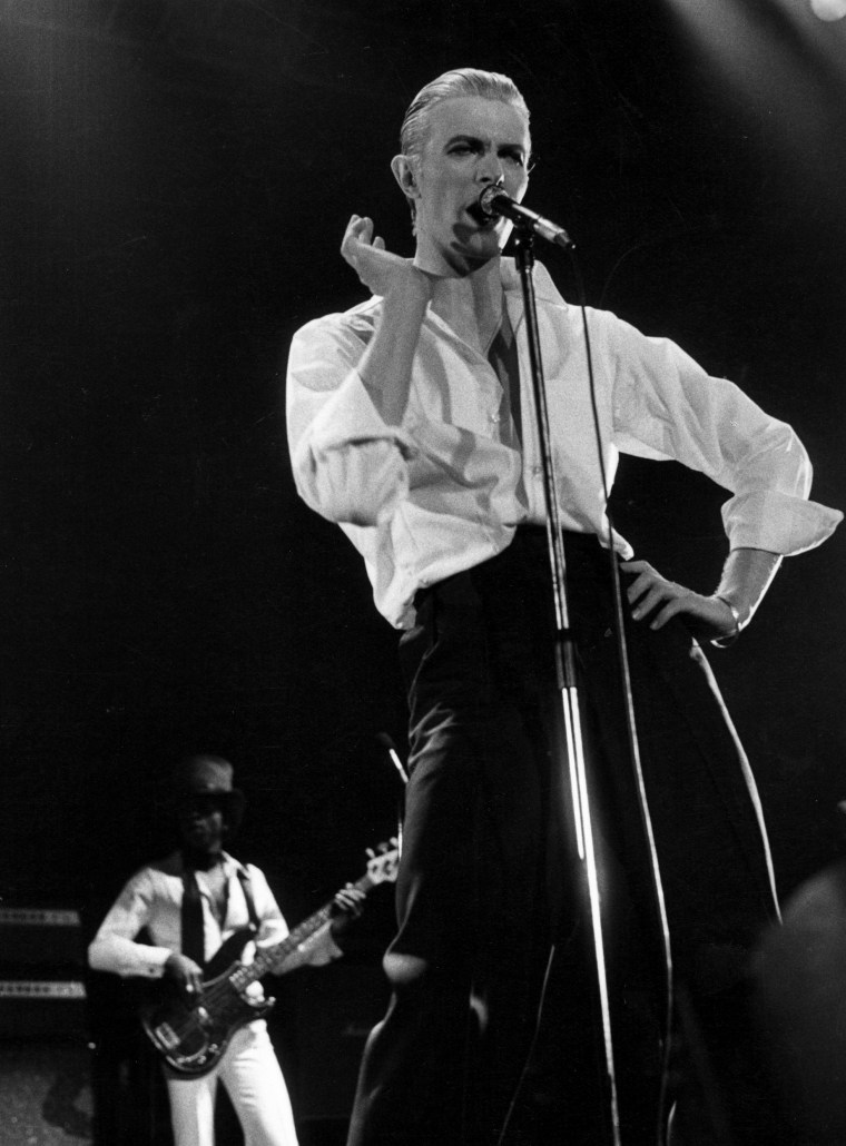 David Bowie, looking androgynous, performs during his 1976 'Station To Station' tour.