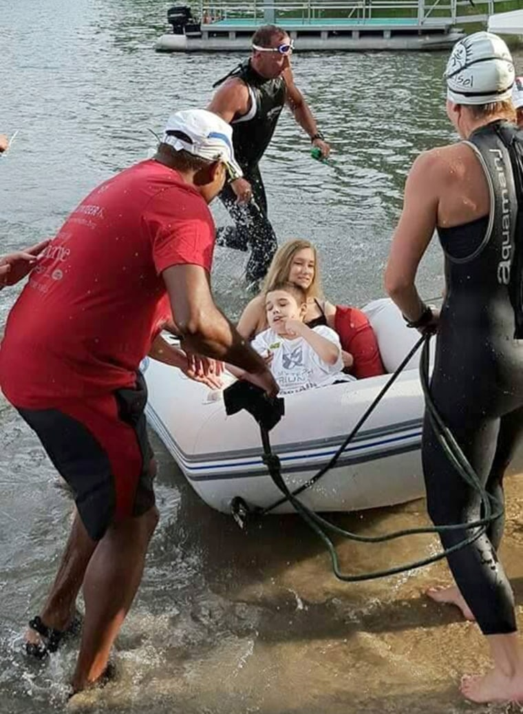 Logan is pulled to shore as a part of the Tri Del Sol triathlon,  a race he also completed through myTEAM TRIUMPH.