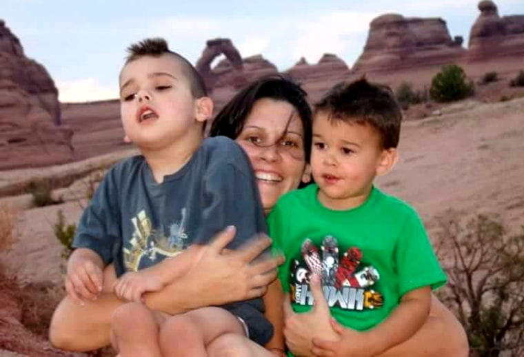 Fleury, Logan, and little brother Leviathan at Delicate Arch in Utah.