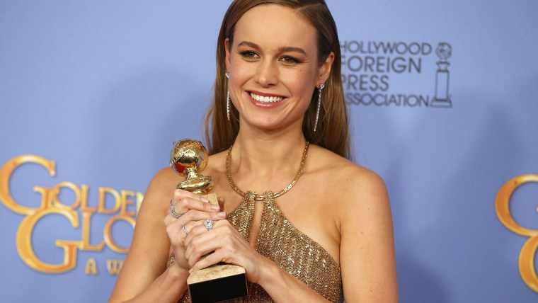 Image: Brie Larson poses with her award during the 73rd Golden Globe Awards in Beverly Hills