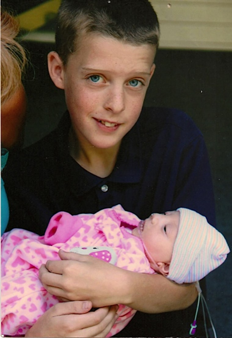 Salchert's son, Andrew, now 16, with Emmalynn.