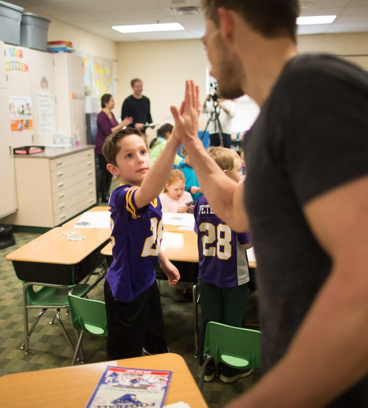 Walsh high-fives a young fan.