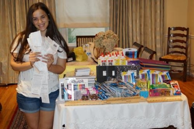 Hannah Steinberg clips coupons to help donate items to charities