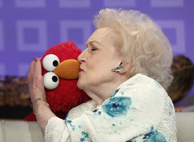 A smooch for Elmo