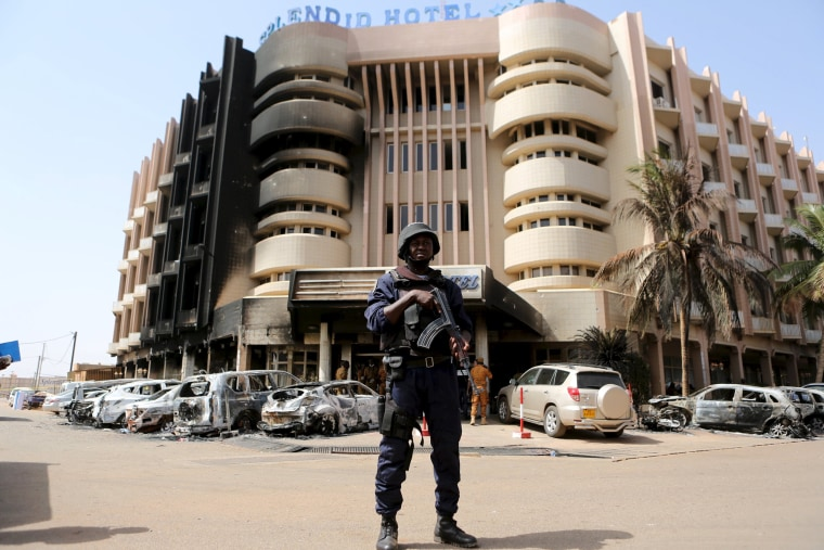 Image: A soldier stands guard in front of Splendid Hotel in Ouagadougou