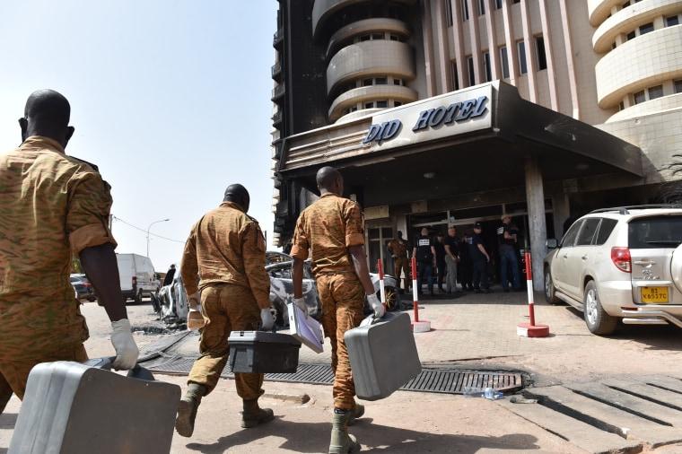 Image: Investigators arrive at the Splendid hotel