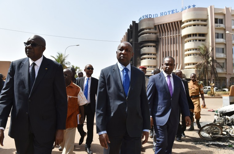 Image: Malian Prime Minister Modibo Keita (L) Burkina Faso's Prime Minister Paul Kaba Thieba (C) and Burkina Faso's foreign Minister Alpha Barry leave after visiting the Splendid hotel