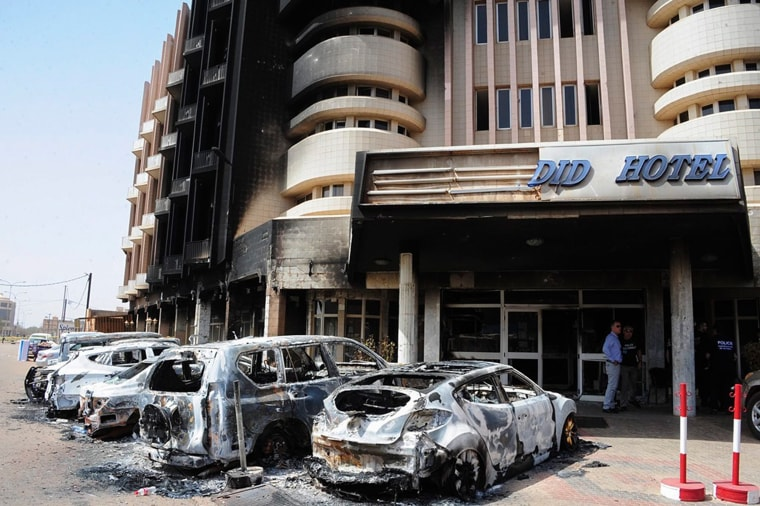 Image: Damaged cars parked out the hotel