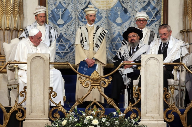 Image: Pope Francis sits at the altar with leaders of the synagogue