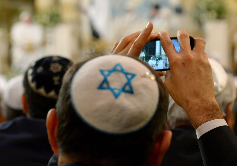 Image: A member of the Rome's Jewish community takes photos of Pope Francis