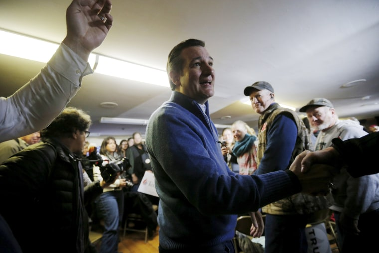 Image: U.S. Republican presidential candidate and U.S. Senator Ted Cruz greets audience members as he arrives for a campaign town hall meeting in Washington