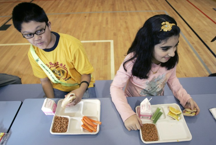 Image: Children in a N.J. school eat lunch