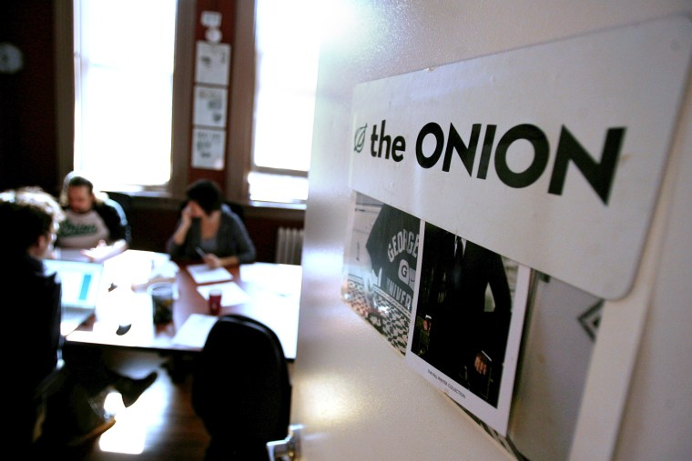Editors and writers work on copy during a drafts meeting at The Onion offices in New York, Thursday, Oct. 30, 2008.
