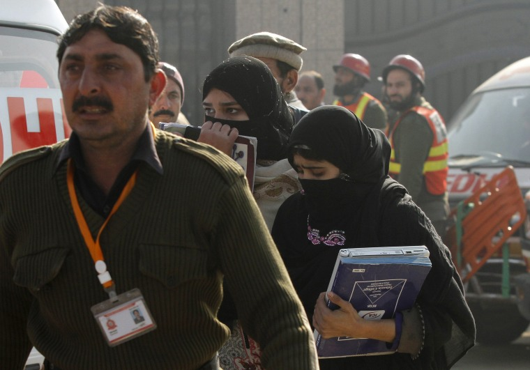 Image: A rescue worker guides students, after they were rescued