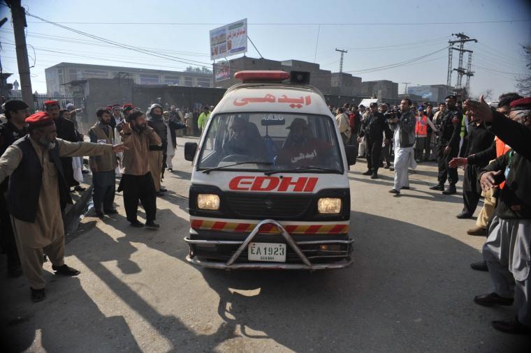 Image: An ambulance carrying injured victims arrives at a hospital