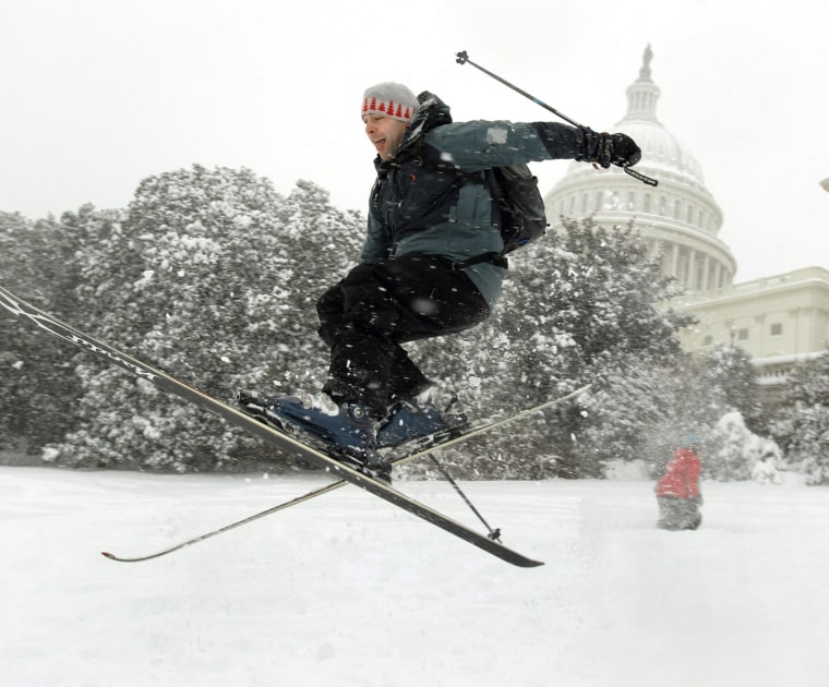 Andrew Kermick, who works on Capitol Hill, goes airborne as he skis in the snow on the West Front of the U.S. Capitol on Dec. 19, 2009.