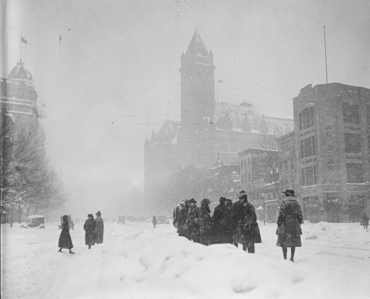 The storm, known as Knickerbocker Snowstorm, caused the roof of Crandall's Knickerbocker Theatre to collapse, killing 98 people and injuring 133 at the time. Above, people walk on the street in January, 1922 in Washington.