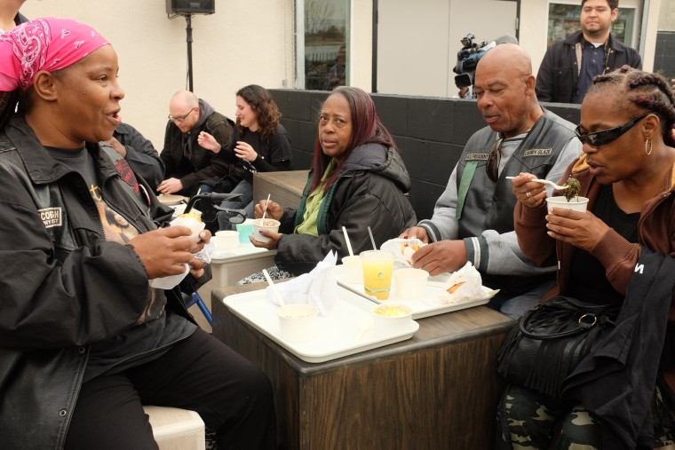 From left: Monique Fields, 47, of Watts; Larry Glaze, 66, of Compton, and Cynthia Simpson, 58, of Compton, eat at Locol in Watts during the restaurant's grand opening.