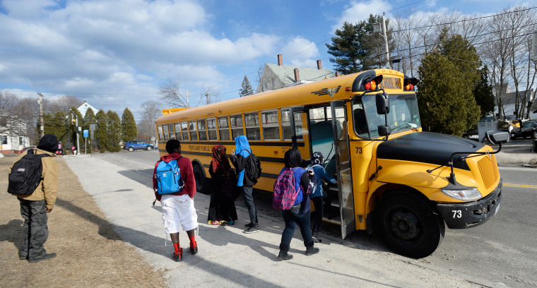 Image: High School students take a bus