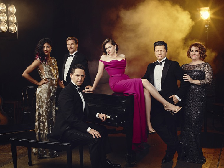 "The cast of ""Crazy Ex-Girlfriend."" Pictured (L-R): Vella Lovell as Heather, Pete Gardner as Darryl, Santino Fontana as Greg, Rachel Bloom as Rebecca, Vincent Rodriguez III as Josh, and Donna Lynne Champlin as Paula."