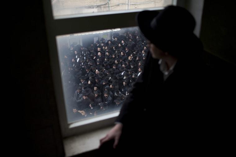 Image: Thousands of Ultra-Orthodox Jews attend the funeral of Rabbi Rafael Shmuelevitz
