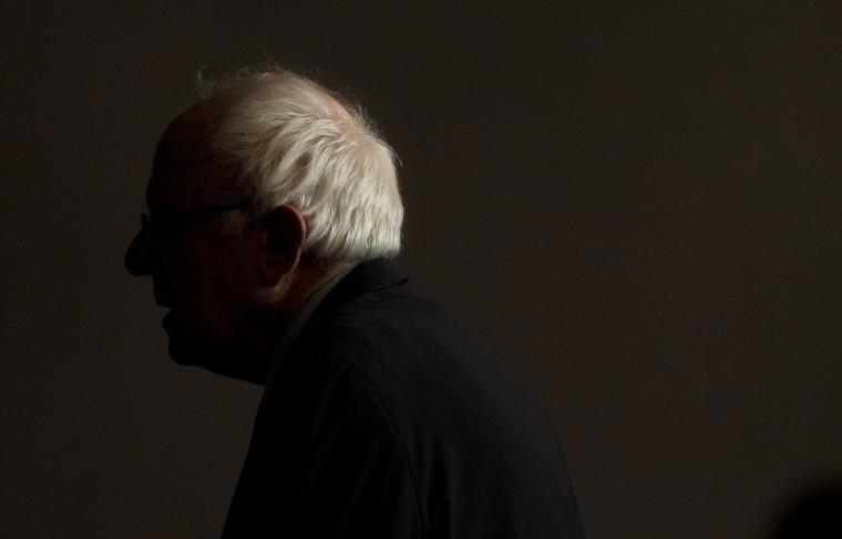 Image: Democratic presidential candidate Sen. Bernie Sanders leaves after speaking to a crowded room in Birmingham
